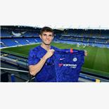 Christian Pulisic poses in Chelsea shirt...
